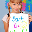 Schoolgirl showing card with text — Stock Photo