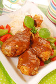 Baked chicken legs with curry — Stock Photo