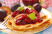 Pancakes with fresh plum`s confiture — Stock Photo