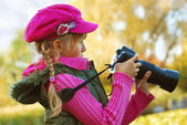 Young photographer in autumn park — Stock Photo