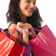 Young woman with shopping bags close-up isolated on white background — Stock Photo