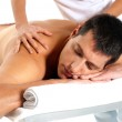 Man receiving massage relax treatment close-up from female hands — Stock Photo