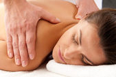 Woman receiving massage relax treatment close-up portrait from male hands — Stock Photo