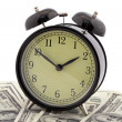 Alarm clock and dollars — Stock Photo