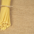 Pasta on sacking — Stock Photo