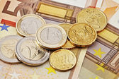 Euro coins and bills — Stock Photo