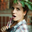 Portrait of the girl with a tree branch — Stock Photo