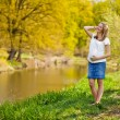 Pregnant woman outdoor spring time — Stock Photo