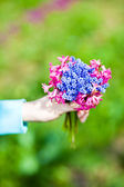 Woman holding flowers bouquet — Stock Photo