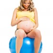 Pregnant woman with gymnastic ball isolated on white — Stock Photo