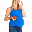 Pregnant woman with vegetables, isolated on white — Stock Photo #6061103