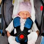 Newborn in car seat — Stock Photo #6640376