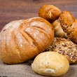 Composition of fresh bread on wood - Stock Photo