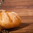 Composition of fresh bread on wood — Stock Photo
