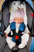 Newborn in car seat — Stock Photo