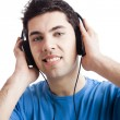 Young man listen music — Stock Photo