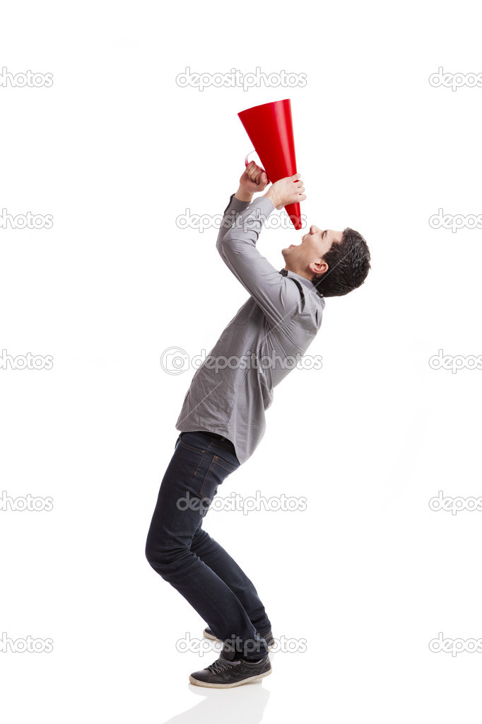 Young man shouting into a megaphone over a white background  — Stock Photo #5388924
