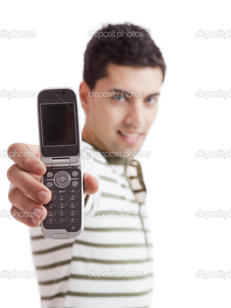 Handsome young man holding and showing a cell phone, isolated on white. Focus is on the phone — Stock Photo #5432145