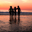 Childrens on the beach - Stock Photo