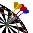 Darts in bullseye on dartboard — Stock Photo