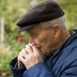 Old man blowing his nose — Stock Photo
