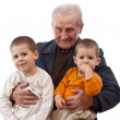 图库照片: Grandfather with his grandsons