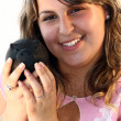 Stock Photo: Young lady Holding Piggy Bank