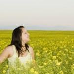 Woman in a flower field — Stock Photo #5894439