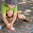 Foto Stock: Boy drawing