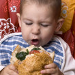 Boy eating hamburger — Stock Photo