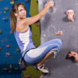 Young, athletic girl climbing — Stock Photo