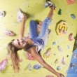 Athletic girl climbing — ストック写真