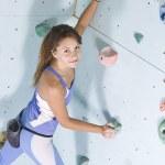 Athletic girl climbing — Stock Photo