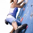 Athletic girl climbing — Photo