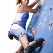 Foto Stock: Athletic girl climbing