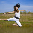 Young woman jumping — Stock Photo #5894691