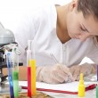 Serious female scientist - Stock Photo