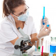 Stock Photo: Young scientist womworking