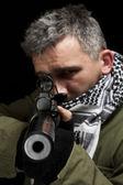 Terrorist whit gun — Stock Photo