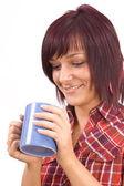 Kobieta z filiżanką herbaty — Zdjęcie stockowe
