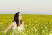 Woman in a flower field — Stock Photo