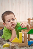 Boy playing with blocks — Foto Stock