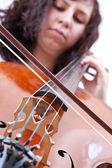Girl playing cello — Stock Photo