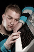 Man play on synthesizer — Stock Photo