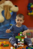 Little boy playing with toy blocks — Stockfoto