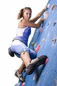 Athletic girl climbing — Stok fotoğraf