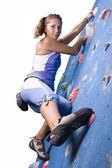 Sportovní holka lezení — Stock fotografie