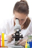 Woman working with a microscope — Foto Stock