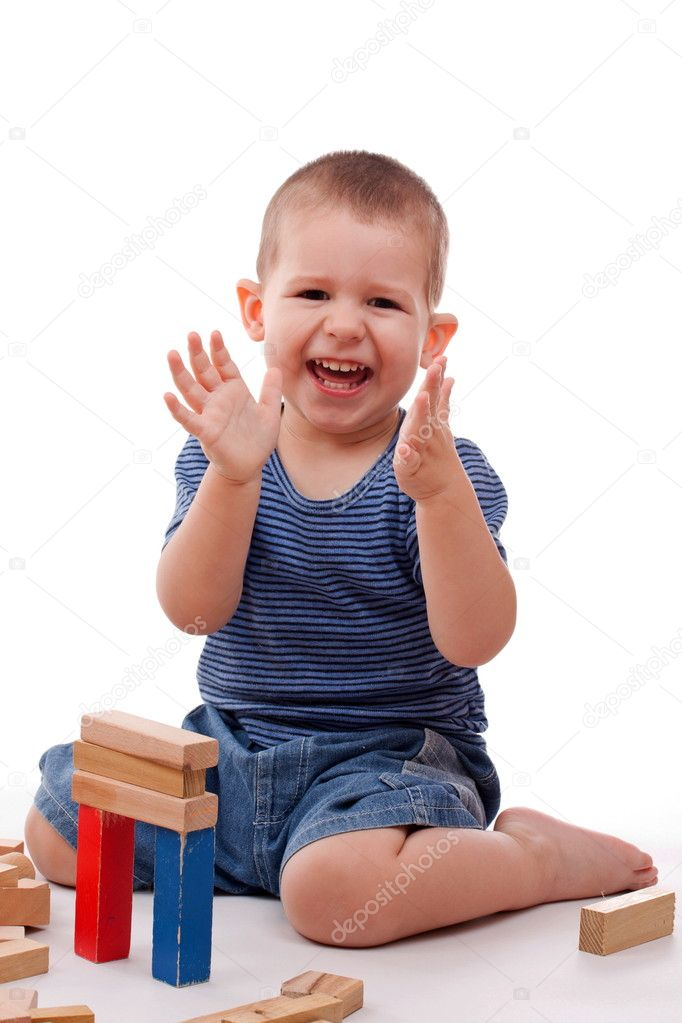 Little boy playing with colorful blocks — Stock Photo #5894587