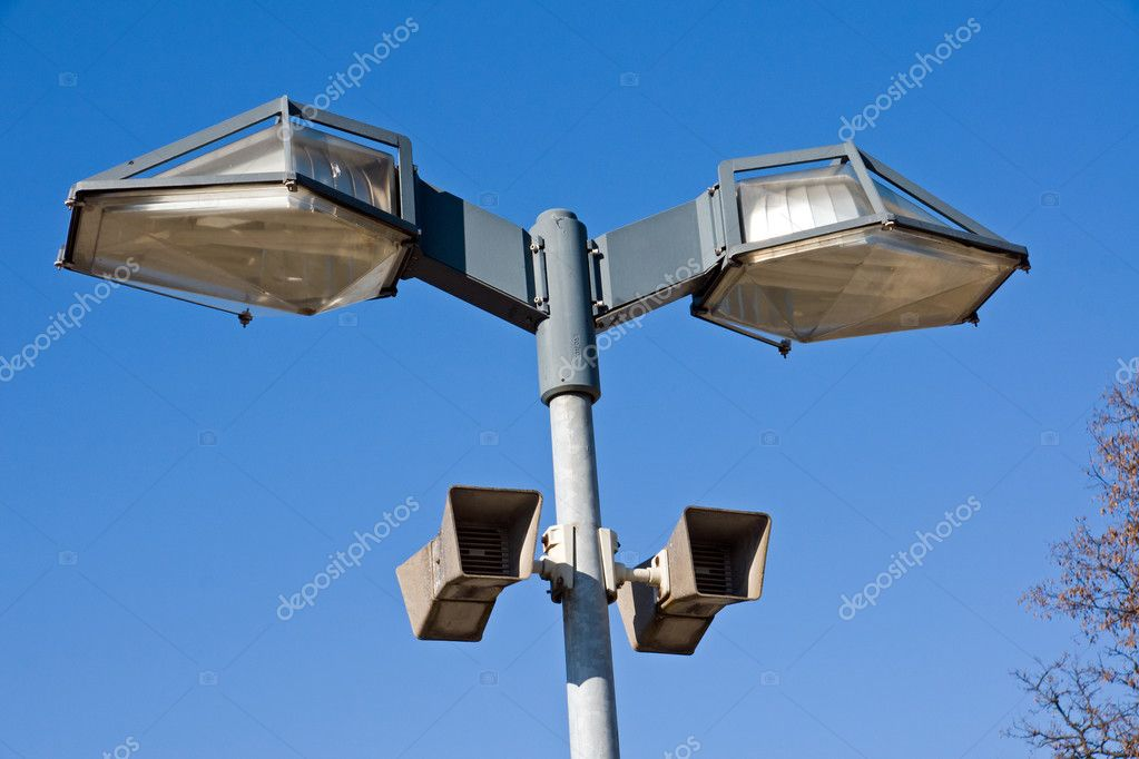 A pair of modern street lights with speakers — Stock Photo #5416317